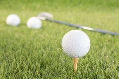 Golf ball on tee. Golf ball sitting on tee putting in golf course. Golf ball on tee ready to be shot Royalty Free Stock Image