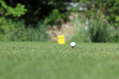 Golf ball. On tee at tee box Royalty Free Stock Photography