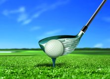 Golf Ball on Tee under Blue Sky Royalty Free Stock Photos