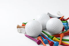 Golf ball and tee. On white background Royalty Free Stock Images