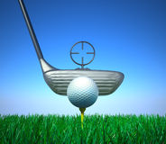Golf ball and tee whith target device Royalty Free Stock Photo