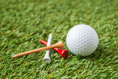 Golf ball and tee Stock Photography
