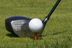 Golf ball Teed up. On red tee ready to be hit by metal driver royalty free stock photos