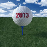 Golf ball teed up to the future 2013 Stock Photos