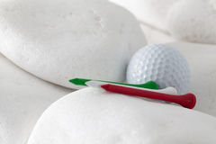 Golf ball and tees between white stones Stock Images