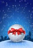 Golf ball tied with a red bow