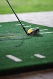 Golf ball on training mate Royalty Free Stock Photo