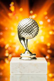 Golf ball trophy against shiny background Royalty Free Stock Image