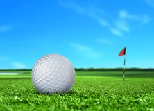 Golf Ball on Turf and Blue Sky Royalty Free Stock Images