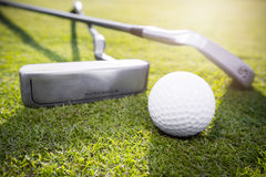 Golf ball. Two golf clubs and golf balls in the grass Stock Image