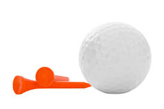 Golf Ball with Two Orange Tees. Blank golf ball with two orange tees on an isolated white background Stock Photography