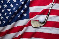 Golf ball with USA flag. Golf ball set on USA flag Royalty Free Stock Image