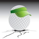 Golf ball with visor on cracked ground Royalty Free Stock Photos