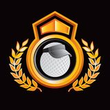 Golf ball with visor on gold royal crest Royalty Free Stock Photography