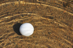 Golf Ball in a Water Hazard Royalty Free Stock Photo