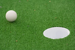 Golf ball. On the way to the hole stock image