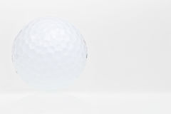 Golf ball  on a white background Royalty Free Stock Photos