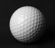Golf ball. White golf ball on black background royalty free stock image