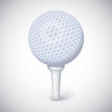 Golf ball on white tee. Royalty Free Stock Photo