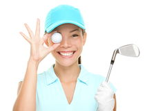 Golf ball woman holding club. Golf fun. Happy woman golf player showing golf ball holding golf club. Funny cute image of Asian Caucasian female golf player Stock Images