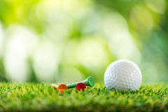 Golf ball and wooden tee Stock Photos