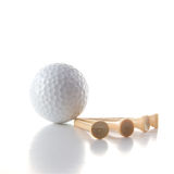 Golf ball and wooden tees. White golf ball isolated against a white background with four wooden tee's. Copy space Stock Photo