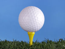Golf ball on yellow tee Stock Image