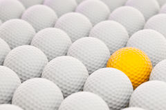 Golf Balls. 3d render of golf balls with colored one to the side royalty free illustration