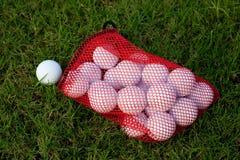 Golf balls. Red bag of practice golf balls Stock Photography