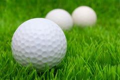 Golf Balls. Group of Golf Balls in Green Grass Stock Photo