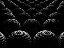 Golf balls. Over dark background Royalty Free Stock Images