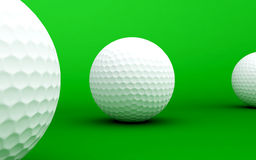 Golf balls. On a green background Royalty Free Stock Photography