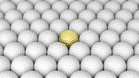 Golf balls. Abstract background with one gold in the middle Royalty Free Stock Photos