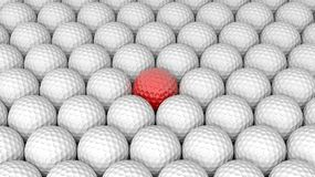 Golf balls. Abstract background with one red in the middle Royalty Free Stock Photos