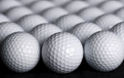 Golf Balls Background. A golf ball background with rows and rows of balls going off into the distance Royalty Free Stock Photography
