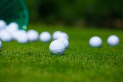 Golf balls basket. Golf ball basket grass equipment leisure activity royalty free stock photography