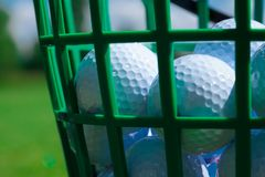 Golf balls basket. Golf ball basket grass equipment leisure activity royalty free stock image