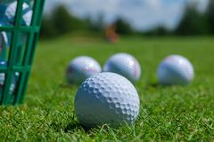 Golf balls basket. Golf ball basket grass equipment leisure activity stock photo