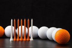 Golf balls on the black background Stock Images