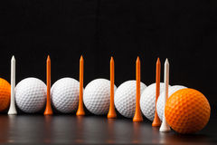 Golf balls on the black background Royalty Free Stock Photos