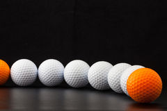 Golf balls on the black background Royalty Free Stock Images