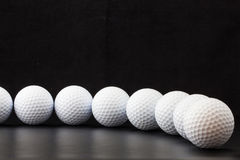 Golf balls on the black background Royalty Free Stock Photo