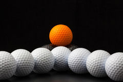 Golf balls on the black background Stock Image