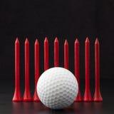 Golf balls on the black background Stock Photo