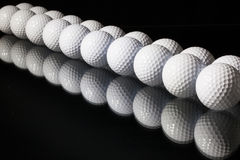 Golf balls on the black background Royalty Free Stock Image