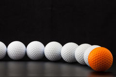 Golf balls on the black background Stock Photography