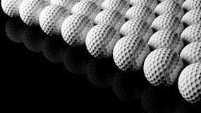 Golf balls. On black background with reflection Royalty Free Stock Images