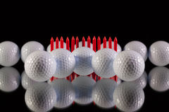 Golf balls on the black glass desk Royalty Free Stock Photo