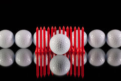 Golf balls on the black glass desk Stock Images