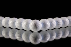 Golf balls on the black table Stock Photo